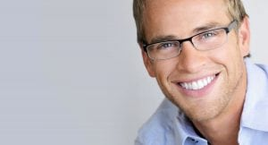 white teeth man smiling with dental implants